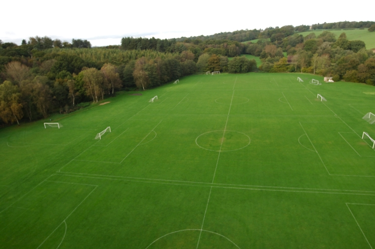 An aerial view of some of Ardingly College's grass football pitches.