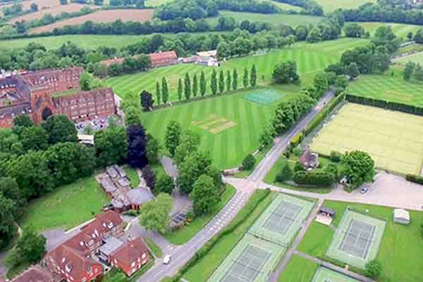 Aerial view of Ardingly college including it's buildings, grounds and sports pitches.