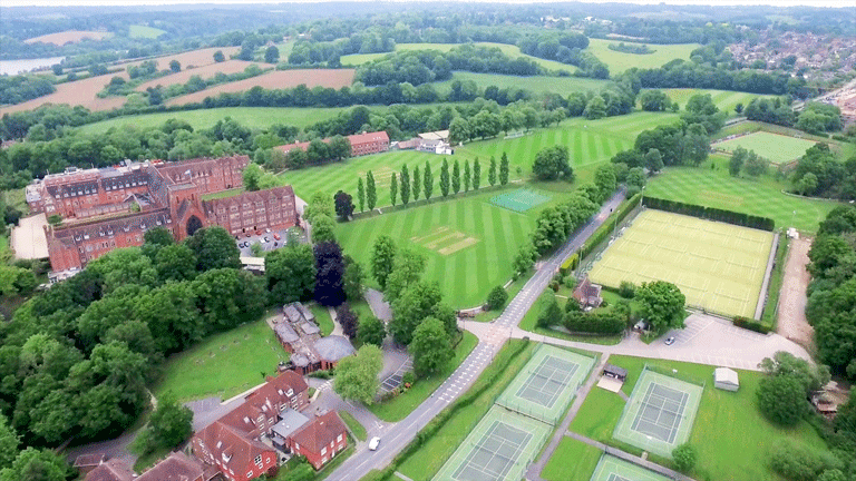 Aerial view of the buildings, grounds and sports pitches at Ardingly College.
