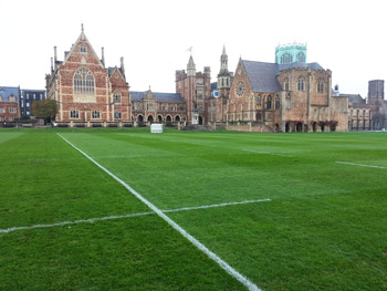 Image of a grass rugby pitch marked out with Ecoline+ paint at Clifton College, with the college buildings in the background.