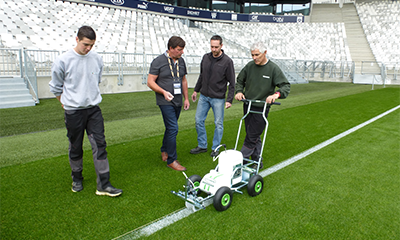 Photo of Pitchmark MD Mark Rodman speaking to grounds staff on the pitch in the Stade Matmut Atlantique, Bordeaux, France.