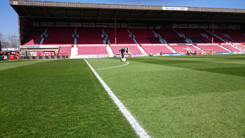 Image of the pitch at the County Ground, home of Swindon Town Football Club, being marked out with Pitchmark's Classic marker and Extreme line marking paint.