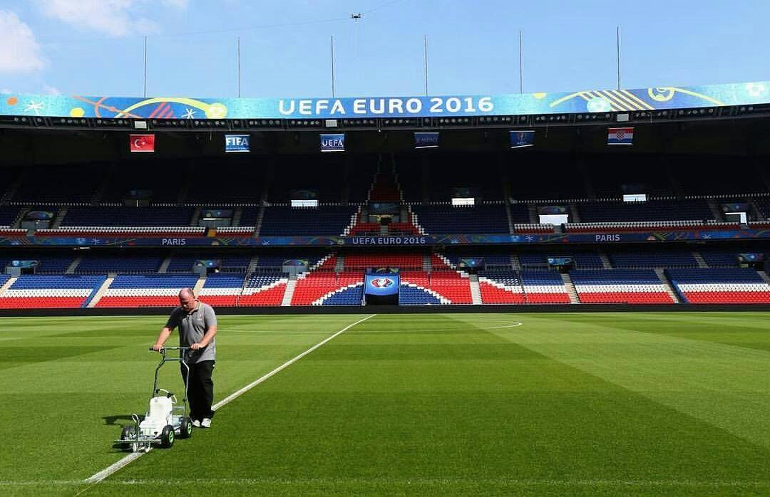 Photo of PSG groundsman Jonathan Calderwood marking out the Parc des Princes pitch prior to a EURO 2016 game.