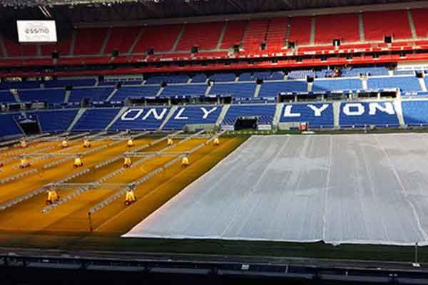 Photo from inside the Parc OL stadium in Lyon, France, looking down on to the pitch.