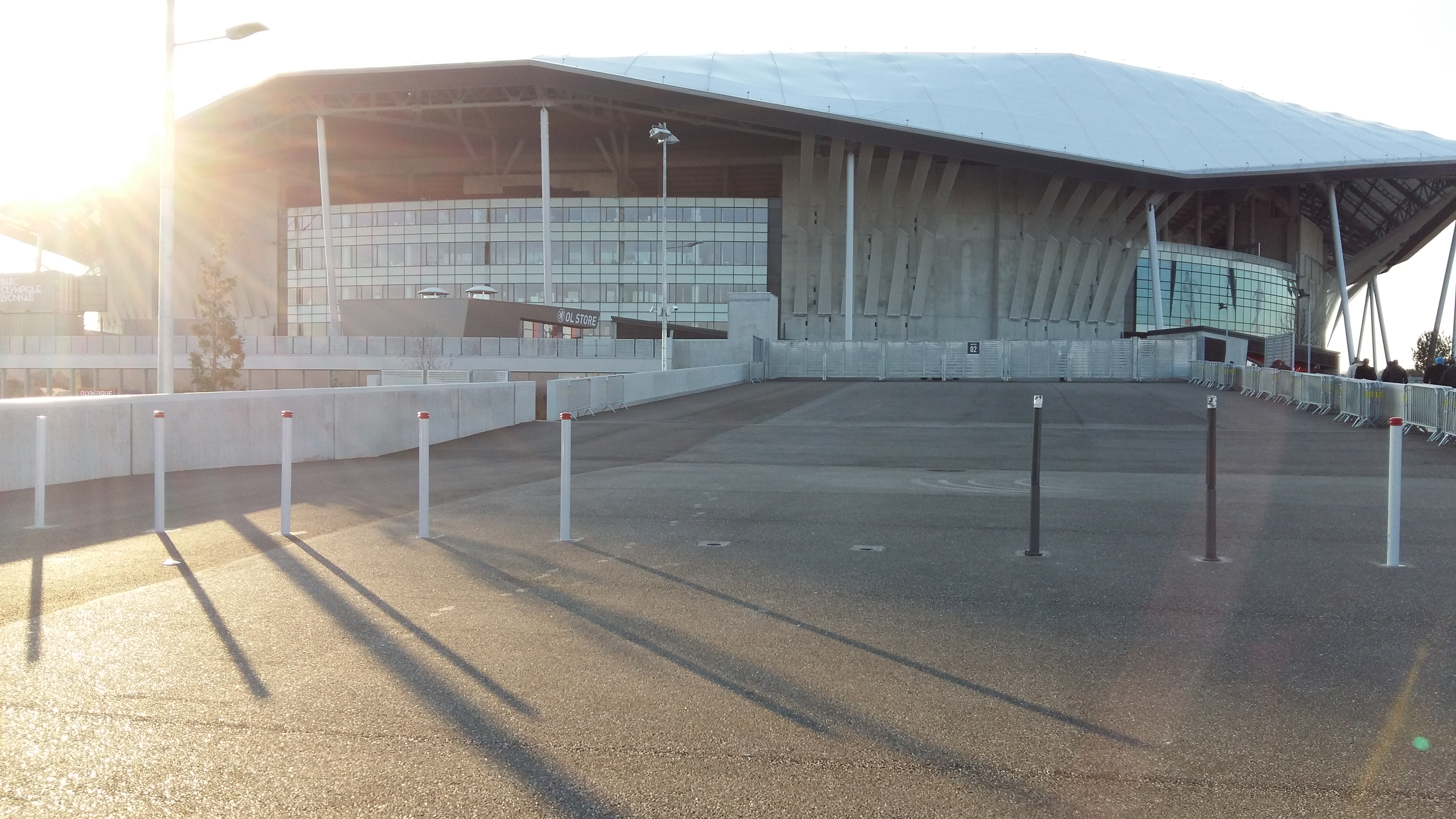 Photo of the outside of the Parc OL stadium in Lyon, France.