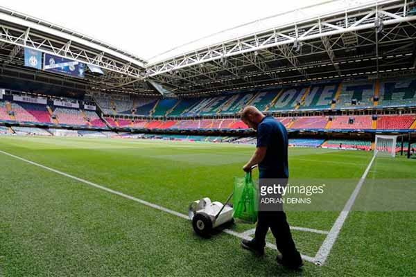 The groundsman at the Principality Stadium in Cardiff marks the pitch out before the Champions League Final.