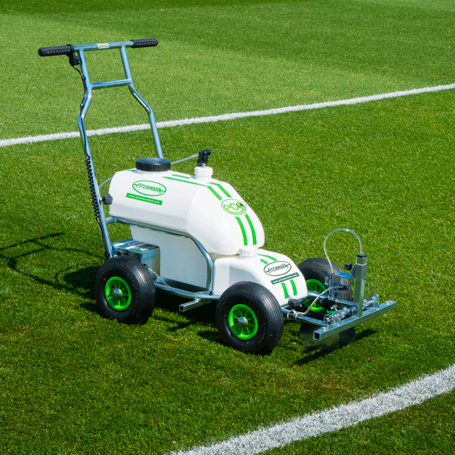 Image of a four-wheeled Eco Pro spray line marker, with white plastic moulded tanks and tubular steel chassis and handlebars, located on a grass sports pitch.