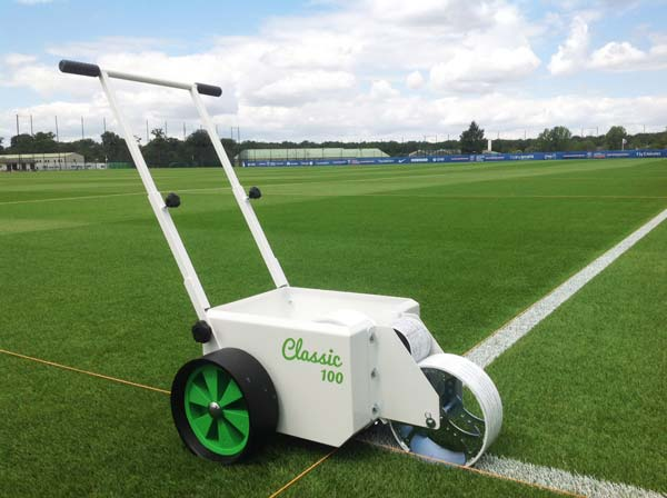 Photo of a Classic-100 wheel-to-wheel line marker on a pitch at PSG's Camp des Loges training centre.