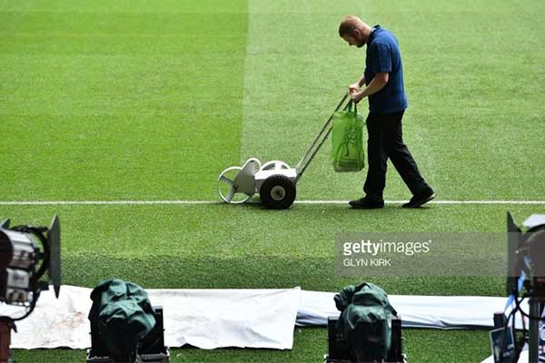 Groundsman marks the Principality Stadium pitch ahead of the Champions League Final 2017 in Cardiff.